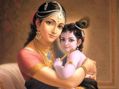 Lord Krishna held in Mothers arms